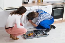 Picture of Washing Machine Repair. This photo was purchased from Adobe Stock.